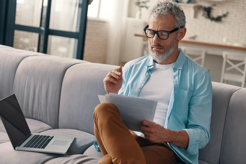 Senior man wearing glasses reading